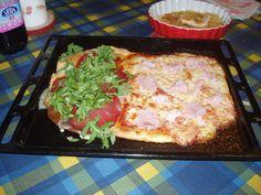 half margherita with ham,half with fontina cheese,bresaola and rucola