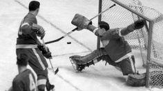 Glenn Hall making an acrobatic save as a member of the Detroit Red Wings. In his rookie season, he would begin his Iron Man streak of 502 consecutive games and post 12 shutouts. Not bad