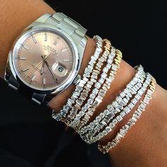 I think I have tooo many diamond bracelets on.....Said no woman ever.  suzanne kalan  stackable baguette bracelets.