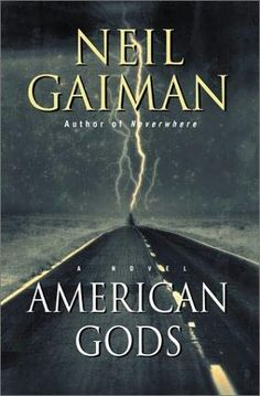 American Gods by Neil Gaiman. The novel is a blend of Americana, fantasy, and various strands of ancient and modern mythology, all centering on a mysterious and taciturn protagonist, Shadow.