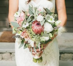 This is a neat and unique bouquet. Protea and air plants wedding bouquet | 100 Layer Cake