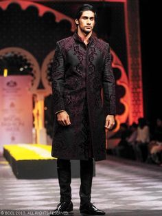 Model Namit Khanna showcases a creation by designer Raghavendra Rathore during India Bridal Fashion Week '13, held at Grand Hyatt, in Mumbai.