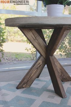 Build this versatile multi-use farmhouse side table as an end table for the living room or as a bedside table. Beginner friendly DIY end table plans for this beautful rustic or modern farmhouse stye planked X side table. Table Beton, Cement Table, Diy Furniture Projects, Diy Furniture Plans, Wood Projects, Woodworking Projects, Woodworking Plans, Furniture Stores, Woodworking Furniture