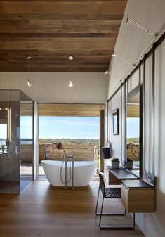 Overlooking the seaside in Montauk, NY, by Bates Masi + Architects. Photograph by Michael Moran.