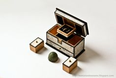 Miniature ivory sewing box filled with incredible tiny antique sewing implements and a 14-15th century thimble.  60mmx40mm. Miniature Treasures, wonderful blog.