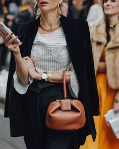 Gold accessories and a chic cognac handbag