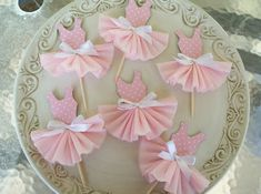 Paper Couture continues with a practical application of the little paper dress with these fresh looking cupcake toppers.     Paper Dress Cup...