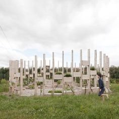 Architecture studio AP+E has created an amphitheatre of timber columns for use as an outdoor teaching space for a primary school in Carlow, Ireland