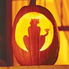 Create a Silhouette    The black cat is a classic Halloween image, and the rounded opening has the look of a glowing moon behind this fierce feline. Tape a stencil to your pumpkin, and use the tip of a nail or ice pick to poke small holes along the lines of the design. Remove the stencil, and use a sharp knife to cut between the holes.