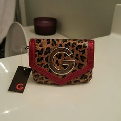 Guess leopard print wallet Little cute wallet with leopard print and some red. This little wallet is perfect little enough to fit comfortable in your hand and in any size purse! As you can tell price tag still on, paper still inside like I bought it :) Guess Bags Wallets