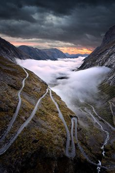 Trollstigen road is one of the main attractions in Norway. It is an amazing steep road on a winding mountain. This road is very narrow and leaves little chance of passing cars among themselves and with their great slope is very, very difficult. But all worth it if you get to the top where you can see all the way from above and Stigfossen waterfall, a waterfall drops 320 meters down the side of the mountain.
