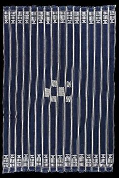 Africa | These distinctive cloths with centrally placed white supplementary weft float patterns on a hand spun indigo dyed cotton ground were worn by senior men among the Gouro and their northern Mande neighbours, and in some cases also by Baule. West Africa | ca. mid 20th century