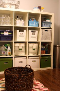 Expedit bookcase in laundry room to hold everything from vacuum cleaner attachements and extra paper towels to household cleaners and lightbulbs.  Awesome!  Altogether, a great laundry room.
