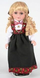 Norwegian doll dressed in a bunad from one of our ancestors' regions (Hallingdal? Gudbansdalen?)
