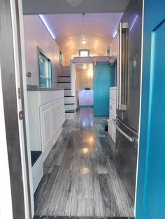 Weathered oak charlotte vinyl flooring is used throughout the tiny house. You'll also find Corian countertops, a side-by-side refrigerator and two large lofts.