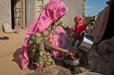 Rajasthan, India: Barefoot College helps to train women to build and repair solar panels. This woman, who has no formal education, now runs her own solar desalinization plant, bringing fresh water to her village.
