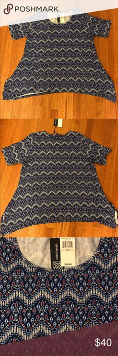 NWT Feather Chevron Tunic Gorgeous tunic top with half short sleeves (longer than traditional short sleeves) in a beautiful chevron tribal feather pattern of navy, light blue, white and coral. Slight shark bite hem is longer on the sides for a flattering drape. Super soft and stretchy 95% viscose, 5% spandex. Similar style to the LuLaRoe Perfect Tee. Cable & Gauge Tops Tunics