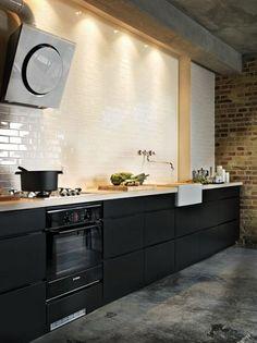 black loftstyle kitchen (raw concrete floor, white subway tiles, white concrete top, white ceramic sink,  black drawers)