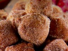 Cinnamon sugar churro bites with Mexican chocolate dipping sauce. These would make great bite sized sweet treats for Cinco de Mayo celebrations.