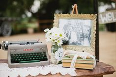 typewriter for notes to bride and groom on rustic display table