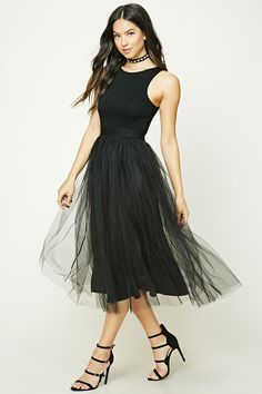 A knit maxi dress featuring a sheer tulle skirt overlay, a sleeveless cut, round neckline, an elasticized waistband, and a small keyhole button back.