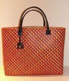Tory Burch straw bag.