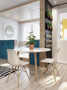 Kleine Wohnung modern und funktionell einrichten_kleines wohnesszimmer mit rundem holzesstisch weiß, loftbett und regal-raumleiler