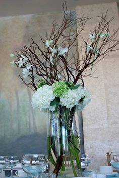 Tall Centerpieces with mazanita branches, hydrangea, roses, dahlias and orchids. I would like it more with purple Orchid Centerpieces, Tall Wedding Centerpieces, Wedding Decorations, Tall Centerpiece, Hortensien Arrangements, Valentines Flowers, May Weddings, Table Flowers, Bridal Flowers