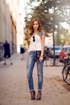Today's Outfit women style clothing outfit fashion blue jeans shoulder bag heels sunglasses white top shirt earrings summer casual street