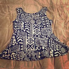 Tribal Peplum Tank Black and off white tribal design worn only twice. Perfect for summer, looks cute with fitted skirts or under a blazer. Forever 21 Tops Tank Tops