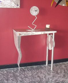 foyer table in brushed aluminum