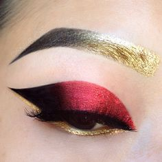 Metallic red eye shadow. Gold liner and brow. Pretty cool although when would you ever? X