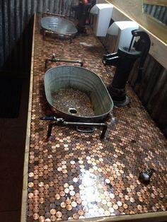 Pennies, old buckets and a pump for the water. This is in the restrooms at Tin Roof BBQ in Atascocita, Texas
