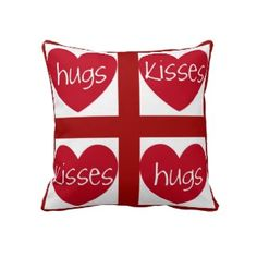 Hugs and Kisses with Red Hearts highlight this loving pillow.