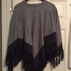 PRICE DROP!!!!  Marc New York Poncho Sweater Never worn though no tag.  Light gray and dark gray with fringe all around poncho sweater. Marc New York Sweaters Shrugs & Ponchos