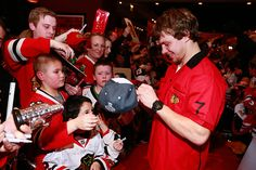 Artemi Panarin signs a hat at Lucky Strike in Chicago. #Blackhawks