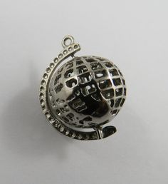 Mechanical Globe That Revolves Sterling Silver Charm or Pendant. A great addition to your charm bracelet.