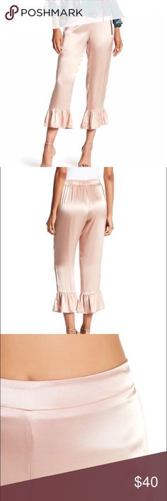 """JUNE AND HUDSON Ruffle Hem Cropped Satin Pants JUNE AND HUDSON Ruffle Hem Cropped Satin Pants in a dusty rose color - Elasticized waistband at back - Ruffle hem - Approx. 11.5"""" rise, 24"""" inseam  - 100% rayon June and Hudson Pants Ankle & Cropped"""