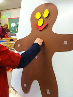velcro items onto the gingerbread man...could draw around one of the children to make the man