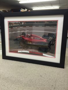 Paul has just finished Framing this signed F1 photo display with a slick black finish frame and red & white Mounts.