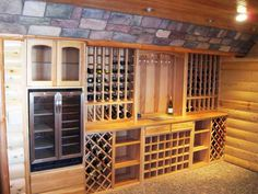 Hickory wine racks, a river-rock floor and stone accents give this wine cellar a rustic, Tuscan look. | thisoldhouse.com