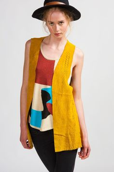 One Teaspoon 'Old Flames' Leather Vest from Koshka - Yellow-dyed Suede with lots of perforation on the front two panel pieces while the back remains solid. This would be great over a super-light summer dress to keep the skirt hem from flying up on a breezy day without adding too much bulk.