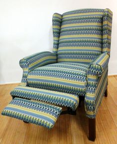 Exceptionnel Reupholstered Reclining Wing Chair.