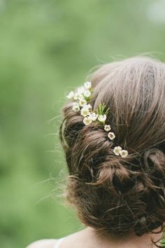 Wax flowers and rosemary tucked into a loose twisted wedding hair // The Natural Wedding Company