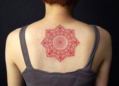 A red geometric tattoo back