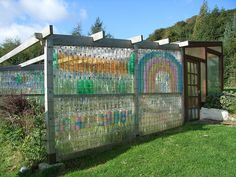 2 liter soda bottles upcycled to build a wall ... would be an awesome green house!