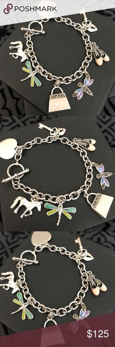 """smc all 925ss charm bracelet perfect condition. 7 1/3"""" in length, all charms and chain are 925 marked. A horse, firefly, pink purse marked on the front with a """"C"""" , butterfly, pink ballet shoes, a heart with a key, and a horse. Beautiful condition. Toggle clasp. Price firm unless bundled. 😍 smc Jewelry Bracelets"""