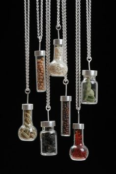 """Single Spice Pendants  2007 sterling silver, handblown glass bottles, whole spices pendants approx. .5"""" x 1"""" x .5"""" 18"""" chain length available in any combination of spice/bottle shape $150 each  Sarah Hood"""