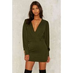Sugar We're Goin' Down Mini Dress ($88) ❤ liked on Polyvore featuring dresses, green, green long sleeve dress, plunging v neck dress, long-sleeve mini dress, short dresses and short green dress