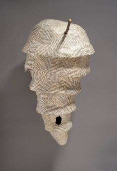 Holly A. Senn from discarded library books. In these labor-intensive works she explores the life cycle of ideas—how ideas are generated, dispersed, referenced or forgotten.